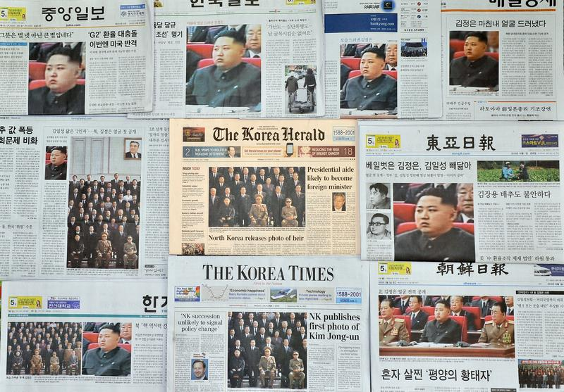 South Korean newspapers carry front-page stories of Kim Jong-Un, the youngest son of North Korean leader Kim Jong-Il, in Seoul on October 1, 2010.