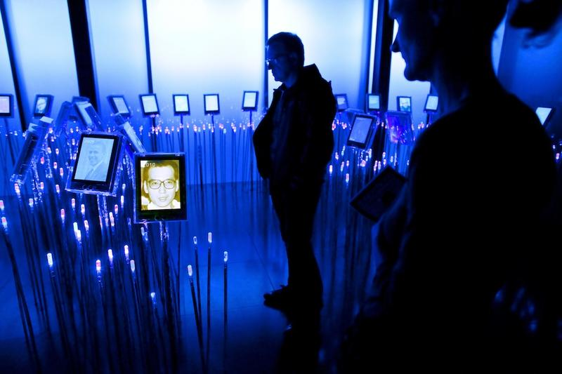 Visitors at the Nobel Peace Centre in Oslo look at pictures of Chinese dissident Liu Xiaobo, who has been awarded the 2010 Nobel Peace Prize and President Obama (L) who was awarded the prize in 2009.