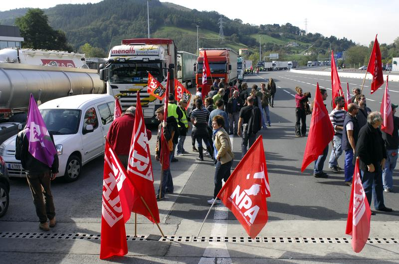 Members of French unions Sud-Solidaires, NPA, Lab, block the A64 highway between France and Spain, on October 22, 2010 in Biriatou, to protest against French government pensions reforms.