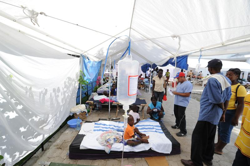 Sick victims and families wait for treatment at St. Nicolas Hospital in St. Marc, north of Port-au-Prince on October 24, 2010, following a cholera outbreak.