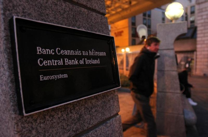 A man leaves the Central Bank of Ireland, in Dublin, Ireland, on November 18, 2010. Ireland could receive 'tens of billions' of euros as part of an EU-IMF bailout.
