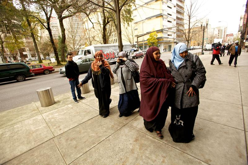 People walk past the media to enter the US Courthouse where suspected Portland car bomber Mohamed Osman Mohamud is having his first court appearance on November 29, 2010 in Portland, Oregon.