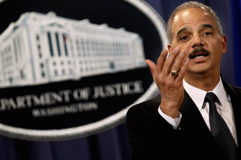 U.S. Attorney General Eric Holder holds a news conference with other officials from the Financial Fraud Enforcement Task Force to announce the results to date of 'Operation Broken Trust.'