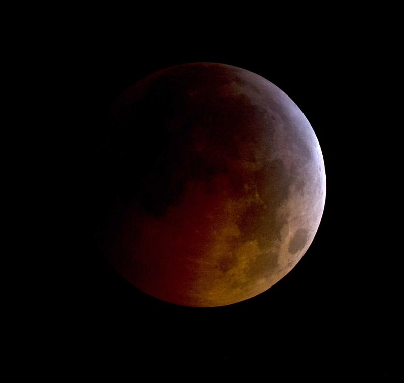 In this handout photo provided by NASA, A total lunar eclipse is seen as the full moon is shadowed by the Earth on the arrival of the winter solstice, on December 21, 2010 in Arlington, Virginia.