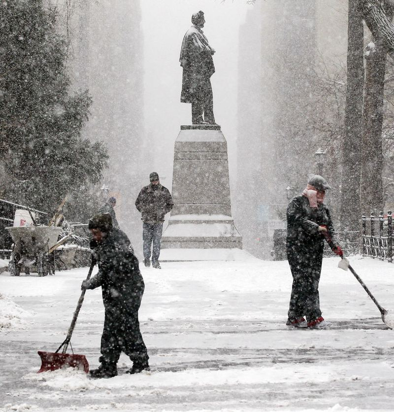 Workers shovel snow in Manhattan's Union Square December 26, 2010 in New York City.