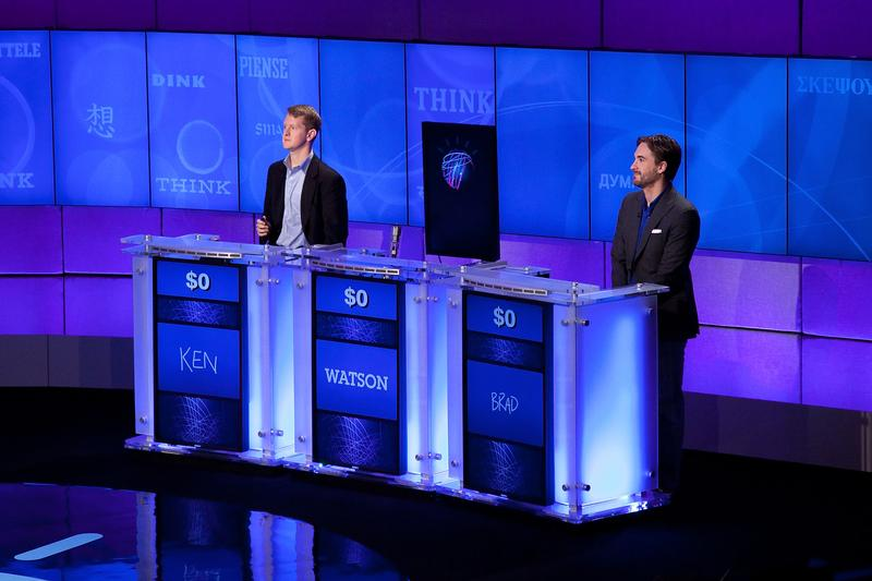 Contestants Ken Jennings and Brad Rutter compete against 'Watson' at a press conference to discuss the upcoming Man V. Machine 'Jeopardy!' competition.