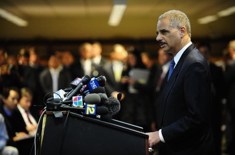 US Attorney General Eric Holder attends a press conference at the US Attorney's Office in New York, January 20, 2011.