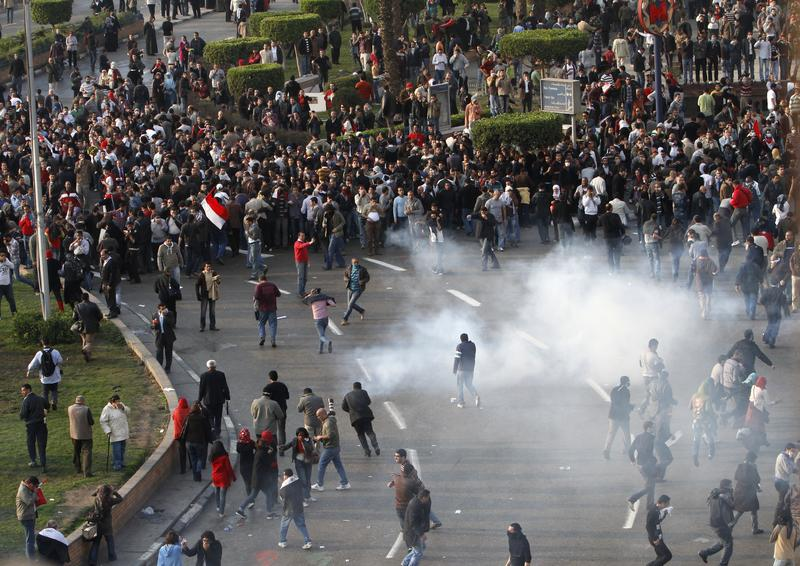 Egyptian demonstrators protest in central Cairo amidst tear gas fire by Egyptian police to demand the ouster of President Hosni Mubarak and calling for reforms on January 25, 2011.