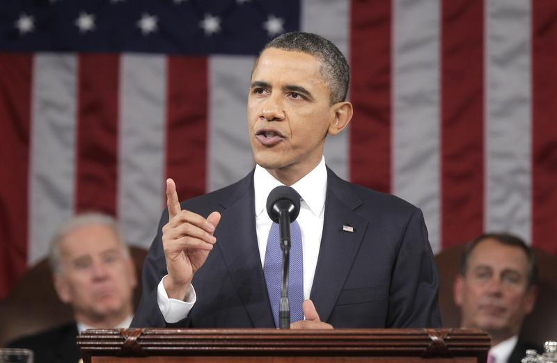 President Obama, flanked by Vice President Joe Biden and House Speaker John Boehner, delivers his second State of the Union Address Jan. 25th.