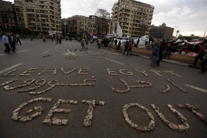 'Leave Egypt Get Out' is written out with stones by Egyptian anti-government protesters in Cairo's Tahrir Square on February 06, 2011.
