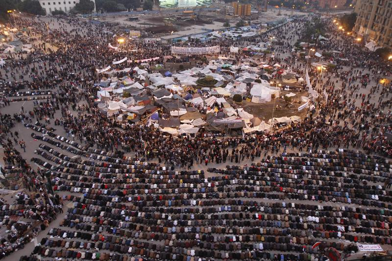 A general view shows Egyptian anti government protesters praying at sunset on Cairo's Tahrir Square, on February 7, 2011, on the 14th days of protests calling for an end to Hosni Mubarak's regime.