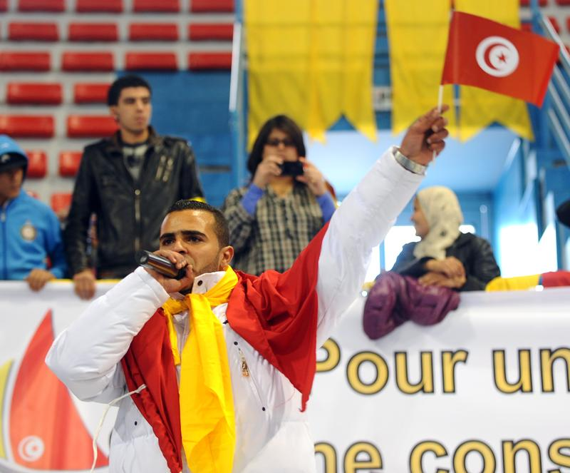 Tunisian rap singer Hamada Ben Amor, also knows as ''The General'' performs during the first meeting of the Tunisia'smain PDP opposition party on January 29, 2011 in Tunis.