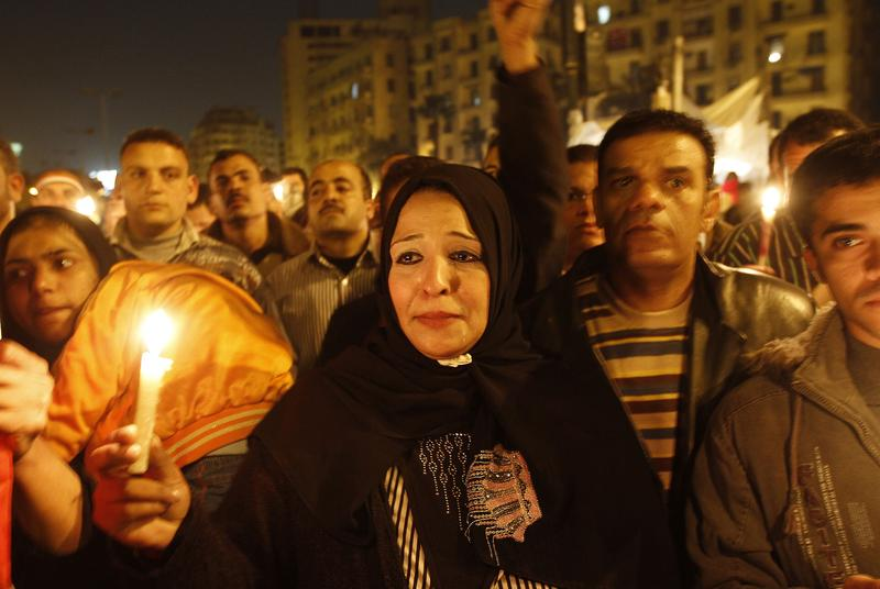 An Egyptian anti-government demonstrator takes part in a candlelight vigil at Cairo's Tahrir Square on February 9, 2011 on the 16th day of consecutive protests calling for the ouster of Mubarak.