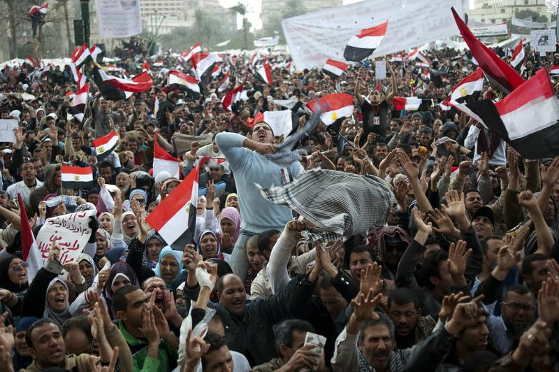 Egyptian anti-government demonstrators chant slogans as tens of thousands gather at Cairo's Tahrir Square on February 10, 2011 amid rumors that Hosni Mubarak appeared to be stepping down.