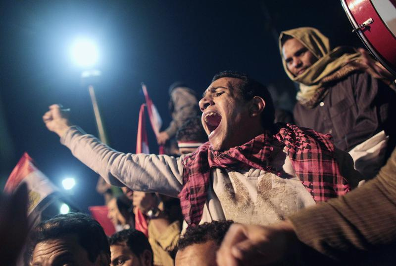 Anti-government protester cheers as news of the possible resignation of Egyptian President Hosni Mubarak seeped into Tahrir Square February 10, 2011 in Cairo, Egypt.
