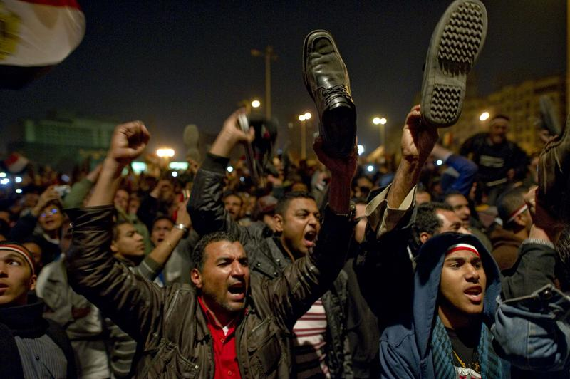 Egyptian anti-government demonstrators wave their shoes as they show their anger during a speech by Egyptian President Hosni Mubarak, who failed to announce his immediate resignation.