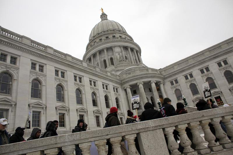 Protesters rally outside the Wisconsin State Capitol on February 21, 2011 in Madison, Wisconsin.