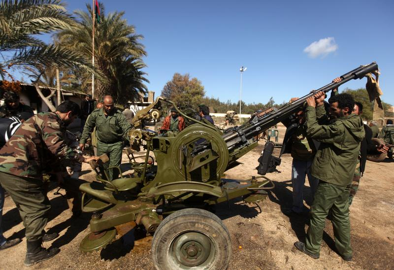 Libyan rebels deploy an anti-aircraft machinegun at a military base in the eastern city of Benghazi on February 28, 2011.