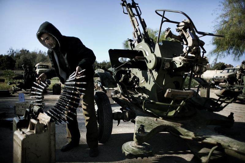 A Libyan civilian holds anti aircraft ammunitions at an army barrack on February 28, 2011 in Benghazi where dozens of civilians registered for a civil defense training amid fears of an air raid.