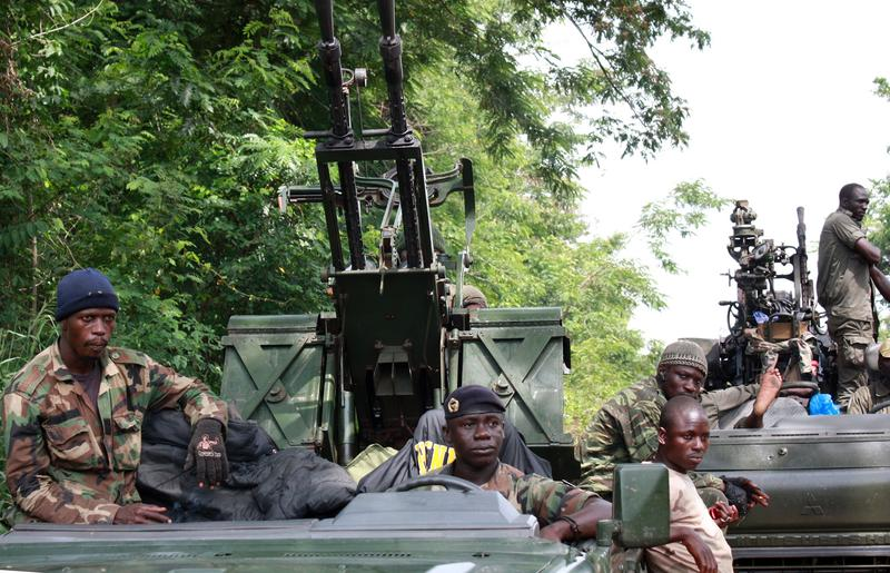 Members of Pro-Ouattara forces hold their weapons on March 29, 2011 in Duekoue, in western Ivory Coast.