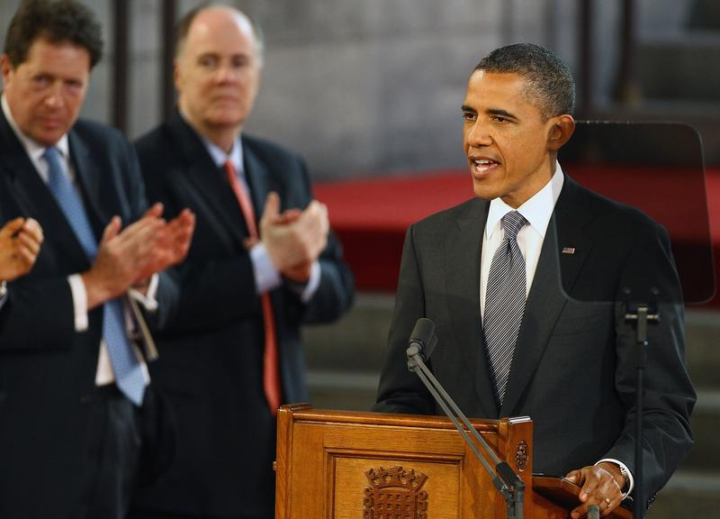 US President Barack Obama is applauded as he delivers a speech at the British parliament in London, on May 25, 2011.