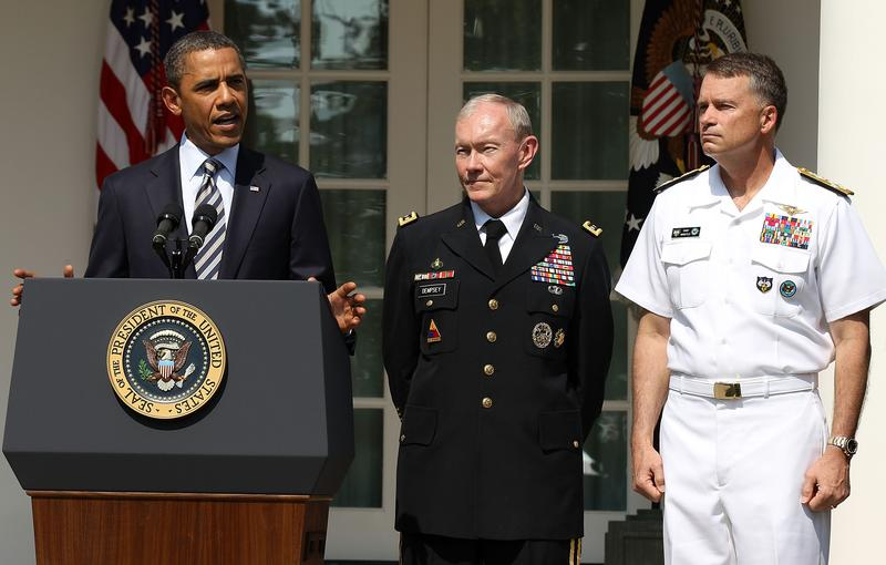 President Barack Obama speaks as Army Chief of Staff Gen. Martin Dempsey, and Navy Admiral James 'Sandy' Winnefeld listen during an event of Department of Defense personnel announcements.