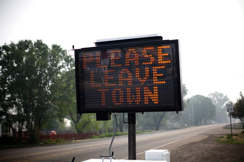 An evacuation asks residents to leave June 9, 2011 in Eagar, Arizona. Hundreds of thousands of acres continue to burn in eastern Arizona prompting evacuations by residents of Springerville and Eagar.