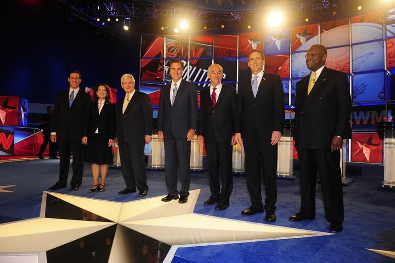Seven GOP presidential contenders on the stage before the Republican presidential debate in Manchester, New Hampshire on June 13, 2011.