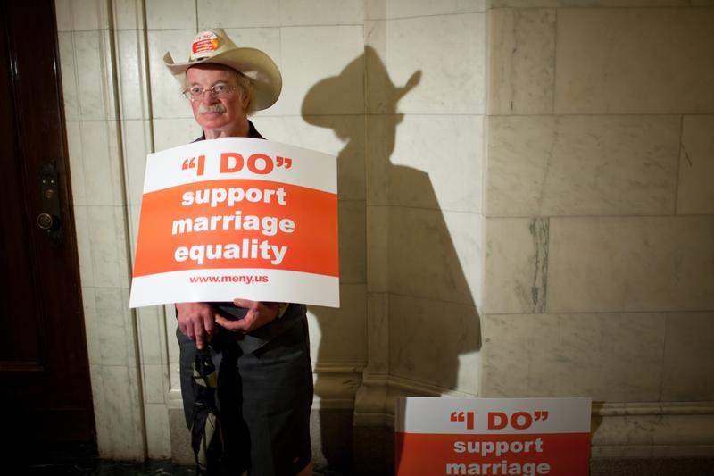 Roger Minch Jr. of Troy, New York, holds a sign in support of a same sex marriage bill outside the New York Senate Chamber on June 17, 2011 in Albany, New York.