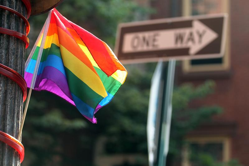 The rainbow flag symbolizing gay pride flies from a pole in Manhattan on June 21, 2011 in New York City.