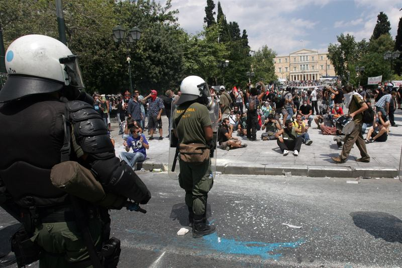 Demonstrators clash with police during a protest against plans for new austerity measures on June 28, 2011 in Athens, Greece.