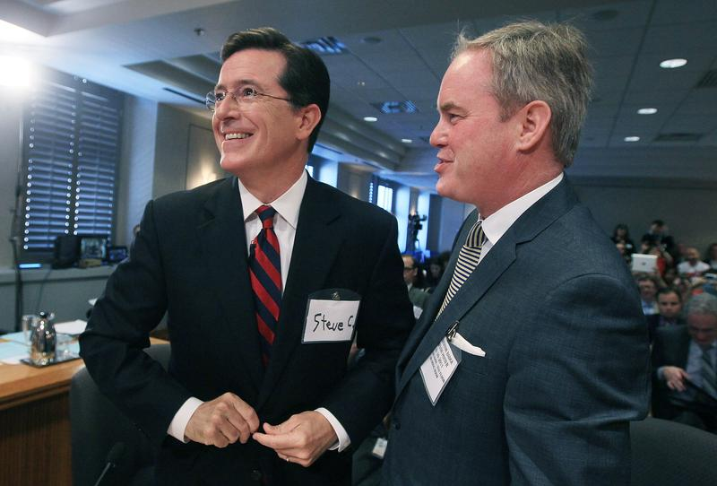 Stephen Colbert (L) stands with his attorney Trevor Potter during an appearance before the FEC to ask for a media exemption to create a political action committee on June 30, 2011 in Washington, DC.