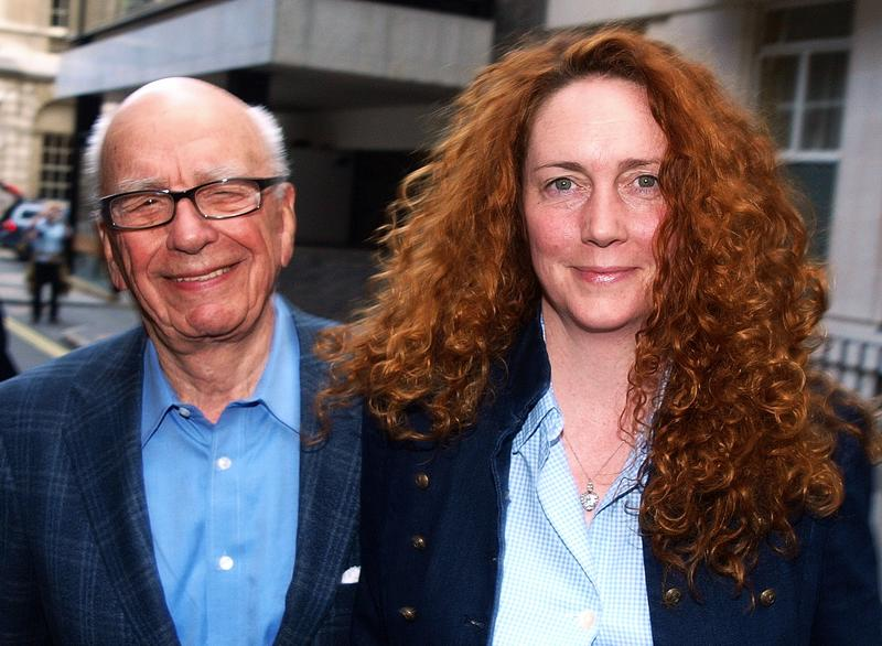 Rebekah Brooks (R) Chief Executive of News International and Rupert Murdoch Chairman of News Corporation leave from his London residence shortly after his arrival in Britain on July 10, 2011.