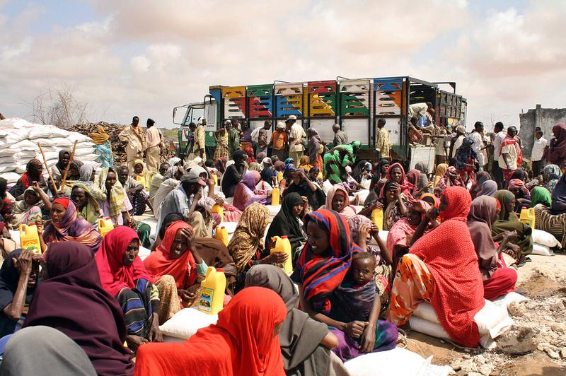 Displaced Somali families receive food-aid July 25, 2011 at an Internally Displaced Person (IDP) camp in Mogadishu.
