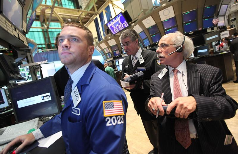 Traders work on the floor of the New York Stock Exchange during morning trading on August 10, 2011 in New York City.
