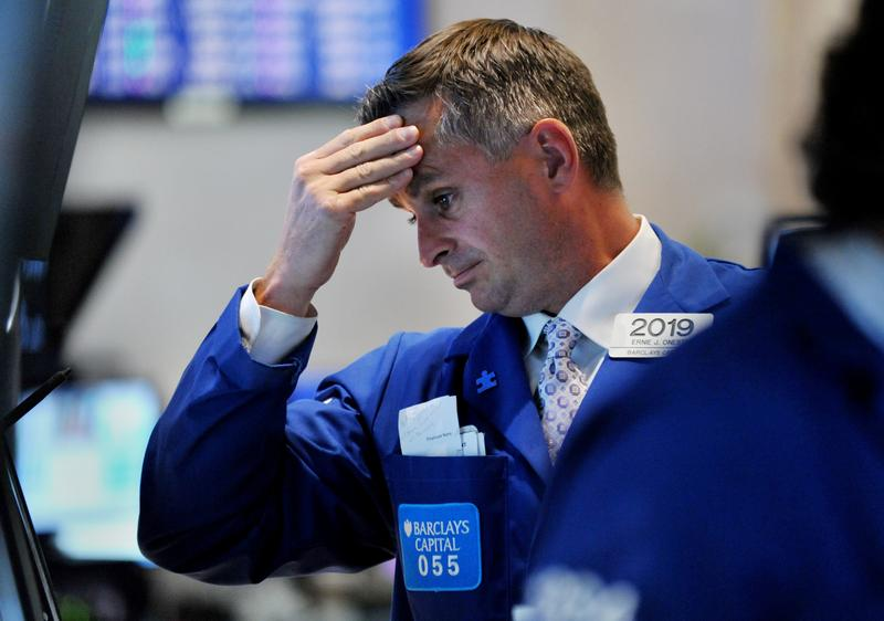 A trader reacts to the market on the floor of the Stock Exchange.