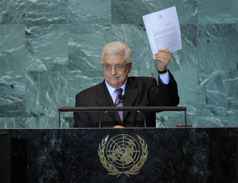 Mahmoud Abbas, President of the Palestinian Authority, holds a copy of the letter requesting Palestinian statehood as he speaks during the United Nations General Assembly September 23, 2011 at UN head
