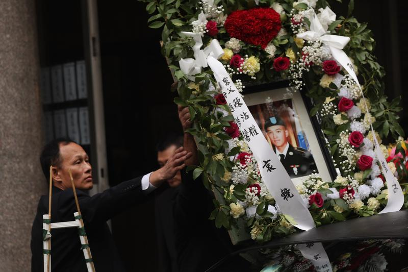 A portrait of Army Pvt. Danny Chen is placed on a car in his funeral procession in Chinatown on October 13, 2011 in New York City.