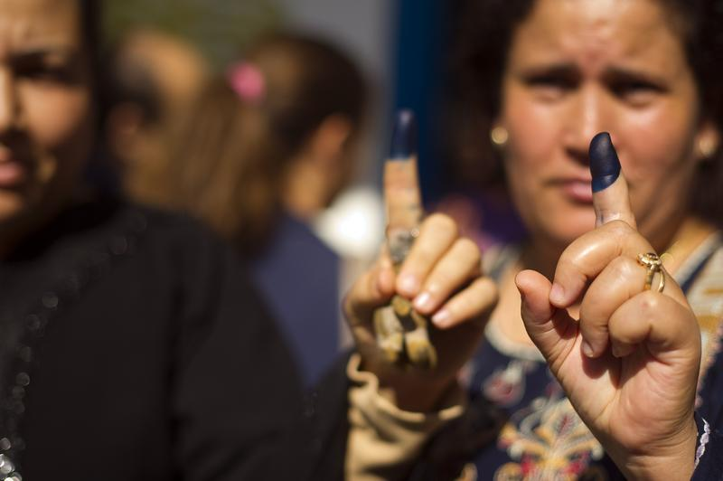Tunisians women show their inked fingers after voting on October 23, 2011, in a polling station in Ettadhamen, a working class part of Tunis.