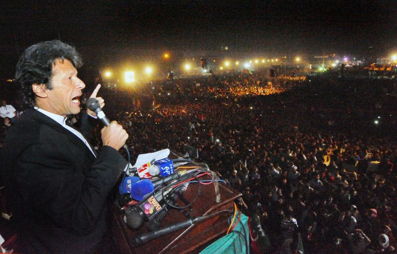 Pakistani politician and former cricketer Imran Khan addresses a rally in Lahore on October 30, 2011.