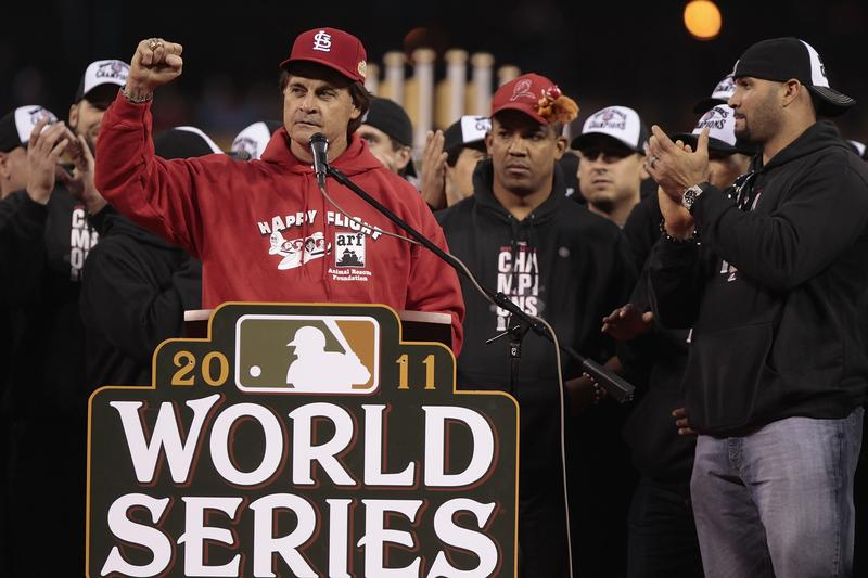Manager Tony La Russa speaks to fans during a ceremony celebrating the team's World Series championship.