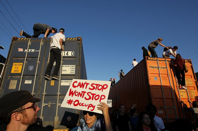 Protestors climb on trucks at the Port of Oakland during Occupy Oakland's general strike.