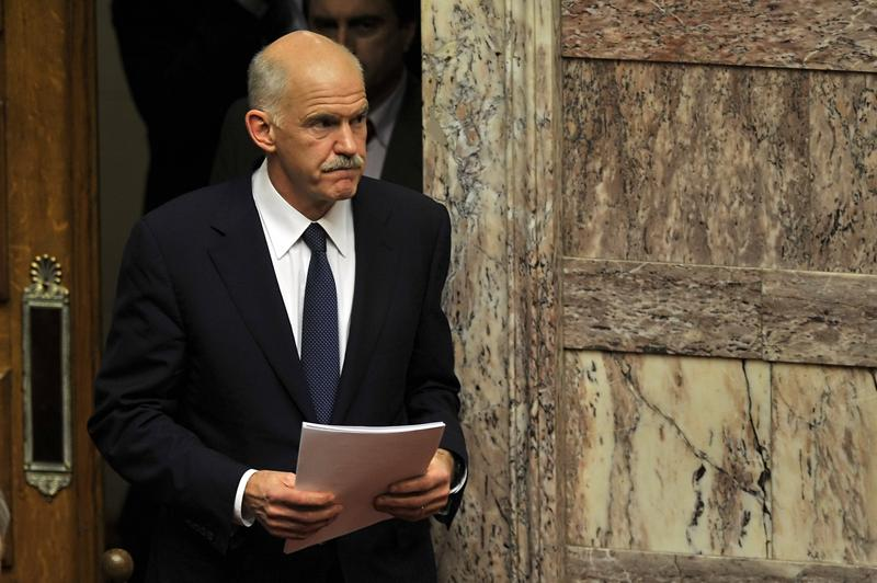 Greek Prime Minister George Papandreou arrives a parliament session on the confidence vote.