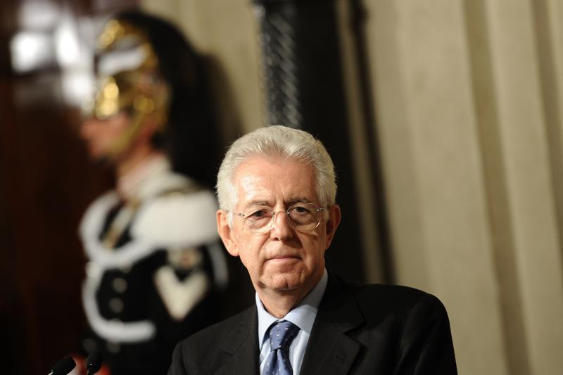 Italy's Prime Minister Mario Monti speaks to the press after being appointed.
