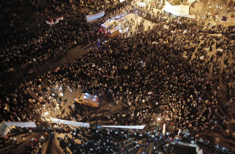 Ambulances make their way through thousands of Egyptian protesters in Tahrir Square in Cairo on November 23, 2011.