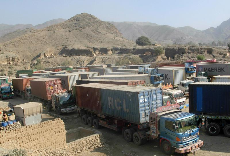 Trucks carrying supplies for NATO forces in Afghanistan are parked at the Pakistan's border crossing after authorities suspended NATO supplies.