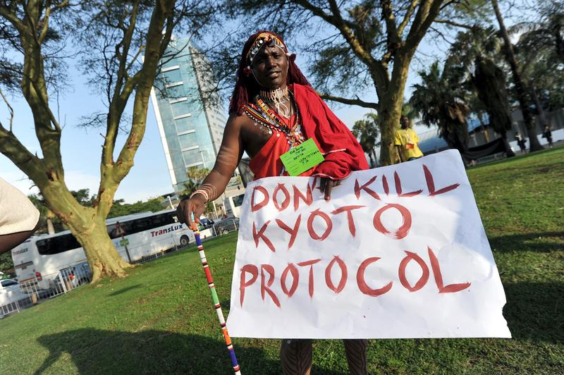 Protester displays a placard during the UN Climate Change conference in Durban.