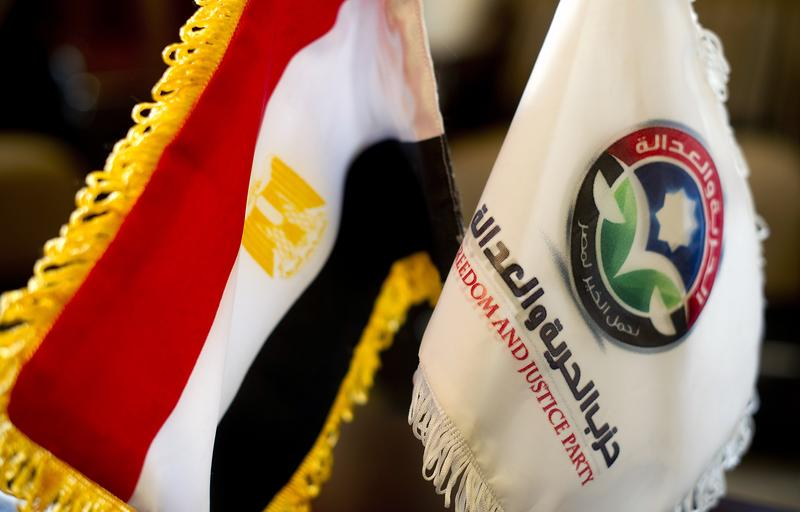 An Egyptian flag is placed next to the flag of the Freedom and Justice Party at the party headquarters in Cairo on November 30, 2011.
