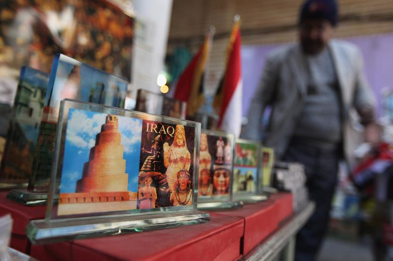 A vendor sells Iraq postcards on December 9, 2011 in Baghdad, Iraq. Iraq is transitioning nearly nine years after the 2003 U.S. invasion and subsequent occupation.