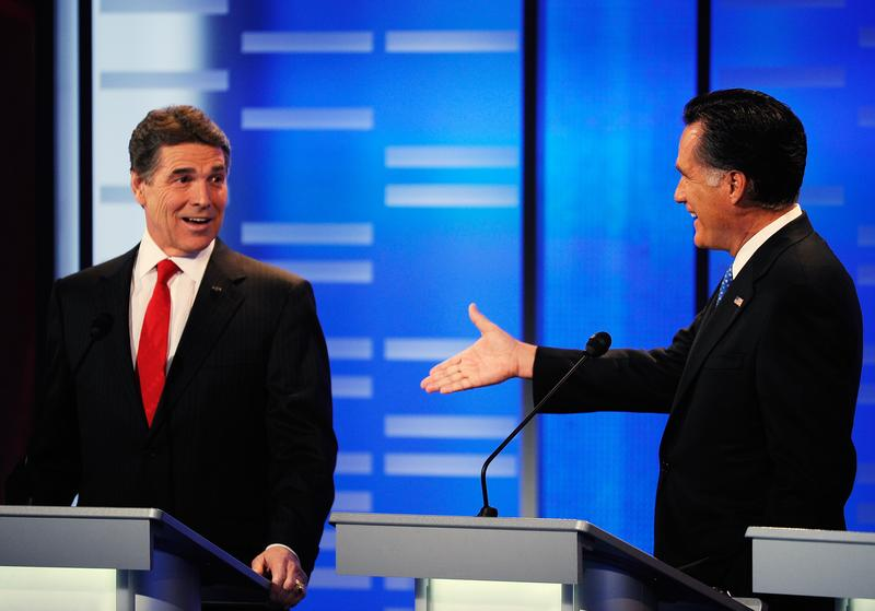 Mitt Romney extends his hand for a $10,000 bet to Texas Gov. Rick Perry.